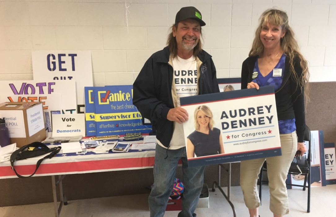 volunteers with audrey denney sign