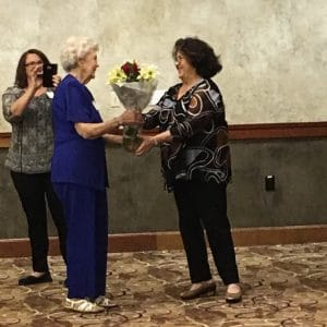 Margaret Earnest, left, receiving the Democrat of the Year award from Chair Diane Kinyon at the 2017 DCCSC Founder's Dinner.
